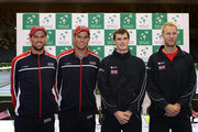 (L-R) Mike Bryan, Bob Bryan of the United States pose with Jamie Murray and Dominic Inglot of The Aegon GB Davis Cup Team ahead of the Davis Cup match between GB and USA at Emirates Arena on March 5, 2015 in Glasgow, Scotland.
