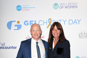CEO of GFI EMEA Julian Swain and Davina McCall, representing Action Medical Research, attend the GFI Charity Day to commemorate the 658 employees who perished on September 11, 2001 in the World Trade Center attacks on  September 11, 2019 in London, England.