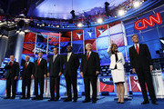 Republican presidential candidates (L-R) Rick Santorum, Rep. Ron Paul (R-TX), Texas Gov. Rick Perry, Mitt Romney, Herman Cain, Newt Gingrich, Rep. Michele Bachmann (R-MN), and Jon Huntsman are introduced prior to a debate at Constitution Hall November 22, 2011 in Washington, DC. The debate, hosted by CNN and in partnership with the Heritage Foundation and the American Enterprise Institute, was expected to focus primarily on national security, foreign policy and the economy.