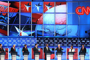 Republican presidential candidates (L-R) Rick Santorum, U.S. Rep. Ron Paul (R-TX), Texas Gov. Rick Perry, Mitt Romney, Herman Cain, Newt Gingrich, U.S. Rep. Michele Bachmann (R-MN), and Jon Huntsman participate in a debate at Constitution Hall November 22, 2011 in Washington, DC. The debate, hosted by CNN and in partnership with the Heritage Foundation and the American Enterprise Institute, was expected to focus on national security, foreign policy and the economy.