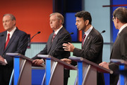 Republican presidential candidates (L-R) Jim Gilmore, Sen. Lindsey Graham (R-SC), Louisiana Gov. Bobby Jindal and Rick Perry participate in a presidential pre-debate forum hosted by FOX News and Facebook at the Quicken Loans Arena August 6, 2015 in Cleveland, Ohio. Seven GOP candidates were selected to participate in the forum based on their rank in an average of the five most recent national political polls.