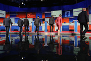 Republican presidential candidates (L-R) Jim Gilmore, Sen. Lindsey Graham (R-SC), Louisiana Gov. Bobby Jindal, Rick Perry, Rick Santorum, Carly Fiorina and George Pataki take their podiums at the beginning of a presidential forum hosted by FOX News and Facebook at the Quicken Loans Arena August 6, 2015 in Cleveland, Ohio. The seven GOP candidates were selected to participate in the forum based on their rank in an average of the five most recent national political polls.