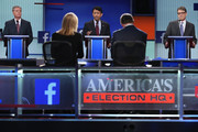 Republican presidential candidates (L-R) Sen. Lindsey Graham (R-SC), Louisiana Gov. Bobby Jindal and Rick Perry participate in a presidential pre-debate forum hosted by FOX News and Facebook at the Quicken Loans Arena August 6, 2015 in Cleveland, Ohio. Seven GOP candidates were selected to participate in the forum based on their rank in an average of the five most recent national political polls.