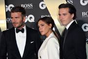 David Beckham, Victoria Beckham and their son Brooklyn Beckham attend the GQ Men Of The Year Awards 2019 at Tate Modern on September 03, 2019 in London, England.