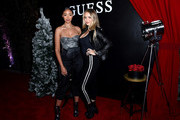 Bella Harris (L) and Raine Michaels attend GUESS Kicks-off Holiday Season at The Peppermint Club on November 07, 2019 in Los Angeles, California.