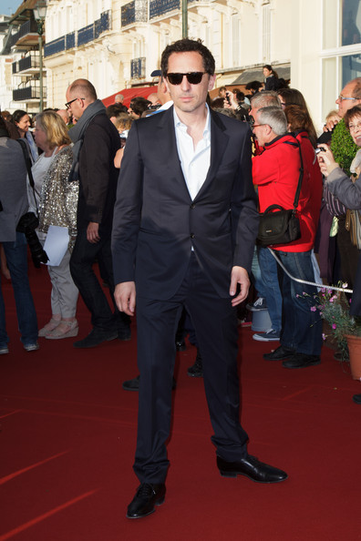 26th Cabourg Film Festival - June 16th [red carpet,suit,carpet,formal wear,premiere,event,flooring,tuxedo,outerwear,blazer,cabourg,france,cabourg film festival,26th cabourg romantic film festival,gad elmaleh]