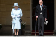 Queen Elizabeth II and the Prince Philip, Duke of Edinburgh arrive for a garden party at Buckingham Palace on June 1, 2017in London, England.