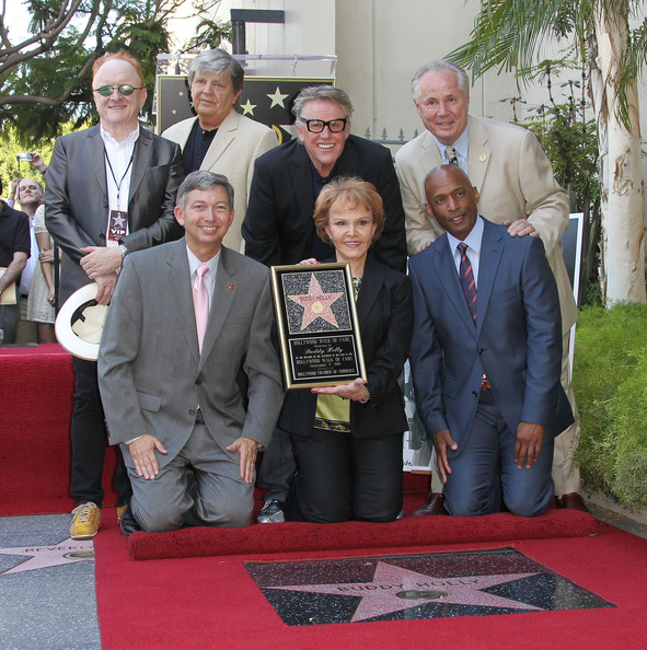 Buddy Holly Star Unveiled On The Hollywood Walk Of Fame [buddy holly,garey busey,guest,ceo,president,maria elena holly,leron gubler,buddy holly star unveiled on the hollywood walk of fame,back row,left,event,suit,award,carpet,flooring,businessperson]
