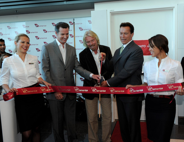 Launch Of Virgin America's 1st International Destination To Toronto [red,event,job,company,team,businessperson,white-collar worker,management,business,arnold schwarzenegger,gavin newsom,richard branson,ribbon,toronto,1st international destination,san francisco,california,virgin america,launch]
