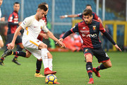 Stephan El Sharaawy (Roma) and Miguel Veloso (Genoa) during the Serie A match between Genoa CFC and AS Roma at Stadio Luigi Ferraris on November 26, 2017 in Genoa, Italy.