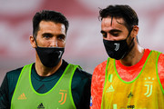 Gianluigi Buffon of Juventus (left) chats with Carlo Pinsoglio of Juventus before the Serie A match between Genoa CFC and Juventus FC at Stadio Luigi Ferraris on June 30, 2020 in Genoa, Italy.