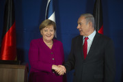 (ISRAEL OUT) Israeli Prime Minister Benjamin Netanyahu (R) and German Chancellor Angela Merkel shake hands after a joint press conferenceon on October 4, 2018 in Jerusalem, Israel. Merkel spoke of Germany's 'everlasting responsibility' to oppose anti-Semitism during a visit to Israel, as she and Netanyahu brushed past their differences and promoted cooperation between their nations.