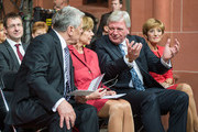 Germans President Joachim Gauck, Daniela Schaad, the Prime minister of Hesse, Volker Bouffier, and Ursula Bouffier attend a church service to celebrate the 25th anniversary of German reunification on October 3, 2015 in Frankfurt, Germany. On October 3, 1990, following the end of the Cold War, western-oriented, capitalist and democratic West Germany and post-revolution, formerly communist East Germany reunited into a single state after 41 years of official separation. Though the integration of the two former states into one is seen by most as a success, differences remain, particularly in average incomes and pensions, which in eastern Germany are lower.