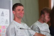 Thomas Mueller of Germany smiles during the press conference after a Germany training session during the 2018 FIFA World Cup at Park Arena Training Ground on June 20, 2018 in Sochi, Russia.