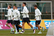 Andre Schuerrle, Mario Goetze, Mario Gomez and Thomas Mueller (L-R) of Germany look on during a Germany training session ahead of their International frindly match  against England at Stadion am Wurfplatz on March 22, 2016 in Berlin, Germany.
