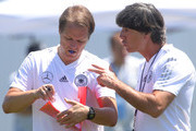 Joachim Loew, Manager of Germany talks to assistan coach Thomas Sschneider during a Germany training session during the 2018 FIFA World Cup at Park Arena Training Ground on June 20, 2018 in Sochi, Russia.