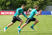 Niklas Suele of Germany and Thomas Mueller of Germany train during the Germany training session ahead of the 2018 FIFA World Cup at CSKA Sports Base on June 14, 2018 in Moscow, Russia.