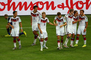 Mario Goetze of Germany (R) celebrates scoring his team's first goal in extra time with teammates Mesut Oezil, Mats Hummels, Toni Kroos, Thomas Mueller, Andre Schuerrle and Philipp Lahm during the 2014 FIFA World Cup Brazil Final match between Germany and Argentina at Maracana on July 13, 2014 in Rio de Janeiro, Brazil.