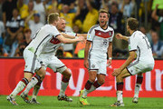 Mario Goetze of Germany (2nd R) celebrates scoring his team's first goal in extra time with teammates Andre Schuerrle, Benedikt Hoewedes and Thomas Mueller during the 2014 FIFA World Cup Brazil Final match between Germany and Argentina at Maracana on July 13, 2014 in Rio de Janeiro, Brazil.