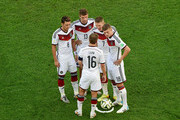 (L-R) Mesut Oezil, Thomas Mueller, Philipp Lahm, Bastian Schweinsteiger and Toni Kroos of Germany prepare to take a free kick during the 2014 FIFA World Cup Brazil Final match between Germany and Argentina at Maracana on July 13, 2014 in Rio de Janeiro, Brazil.
