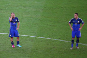A dejected Sergio Aguero (L) Maxi Rodriguez of Argentina look on after being defeated by Germany 1-0 in extra time during the 2014 FIFA World Cup Brazil Final match between Germany and Argentina at Maracana on July 13, 2014 in Rio de Janeiro, Brazil.