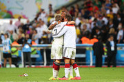 (L-R) Bastian Schweinsteiger, Jerome Boateng and Miroslav Klose of Germany celebrate after defeating Argentina 1-0 in extra time during the 2014 FIFA World Cup Brazil Final match between Germany and Argentina at Maracana on July 13, 2014 in Rio de Janeiro, Brazil.