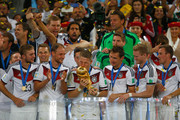 Bastian Schweinsteiger of Germany kisses the World Cup trophy with teammates after defeating Argentina 1-0 in extra time during the 2014 FIFA World Cup Brazil Final match between Germany and Argentina at Maracana on July 13, 2014 in Rio de Janeiro, Brazil.
