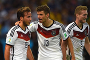 Mario Goetze of Germany celebrates scoring his team's first goal in extra time with teammates Thomas Mueller (C) and Andre Schuerrle (R) during the 2014 FIFA World Cup Brazil Final match between Germany and Argentina at Maracana on July 13, 2014 in Rio de Janeiro, Brazil.