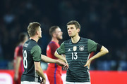 Toni Kroos talks with Thomas Mueller of Germany  during the international friendly match between Germany and England at Olympiastadion on March 26, 2016 in Berlin, Germany.