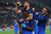 (L to R) Patrice Evra, Olivier Giroud and Antoine Griezmann of France celebrate their team's 2-0 win in the UEFA EURO semi final match between Germany and France at Stade Velodrome on July 7, 2016 in Marseille, France.