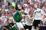 Hugo Ayala of Mexico wins a header over Timo Werner of Germany during the 2018 FIFA World Cup Russia group F match between Germany and Mexico at Luzhniki Stadium on June 17, 2018 in Moscow, Russia.