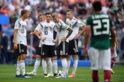 Germany players show their dejection following Mexico's first goal during the 2018 FIFA World Cup Russia group F match between Germany and Mexico at Luzhniki Stadium on June 17, 2018 in Moscow, Russia.