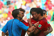 Pepe of Portugal (R) reacts after receiving a red card by referee Milorad Mazic during the 2014 FIFA World Cup Brazil Group G match between Germany and Portugal at Arena Fonte Nova on June 16, 2014 in Salvador, Brazil.