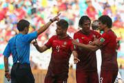 Pepe of Portugal (R) reacts after receiving a red card by referee Milorad Mazic as teammates Miguel Veloso (2nd L) and Bruno Alves react during the 2014 FIFA World Cup Brazil Group G match between Germany and Portugal at Arena Fonte Nova on June 16, 2014 in Salvador, Brazil.