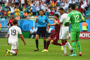 Referee Milorad Mazic awards a penalty kick after Mario Goetze of Germany is fouled as Pepe of Portugal protests during the 2014 FIFA World Cup Brazil Group G match between Germany and Portugal at Arena Fonte Nova on June 16, 2014 in Salvador, Brazil.