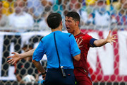 Cristiano Ronaldo of Portugal reacts toward referee Milorad Mazic during the 2014 FIFA World Cup Brazil Group G match between Germany and Portugal at Arena Fonte Nova on June 16, 2014 in Salvador, Brazil.