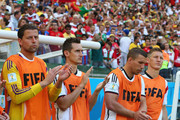 Miroslav Klose of Germany (second from left), Lukas Podolski and Bastian Schweinsteiger look on from the bench during the 2014 FIFA World Cup Brazil Group G match between Germany and Portugal at Arena Fonte Nova on June 16, 2014 in Salvador, Brazil.
