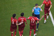 Nani of Portugal leads the protest to referee Milorad Mazic during the 2014 FIFA World Cup Brazil Group G match between Germany and Portugal at Arena Fonte Nova on June 16, 2014 in Salvador, Brazil.