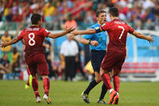 Joao Moutinho (L) and Cristiano Ronaldo of Portugal (R) react toward referee Milorad Mazic during the 2014 FIFA World Cup Brazil Group G match between Germany and Portugal at Arena Fonte Nova on June 16, 2014 in Salvador, Brazil.