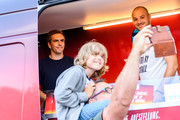 Philipp Lahm serves ice cream at the National Team Fan Club . ahead of the international friendly match between Germany and Saudi Arabia at BayArena on June 8, 2018 in Leverkusen, Germany.