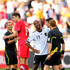 Alberto Undiano Photos - Cacau of Germany shares a joke with referee Alberto Undiano after the 2010 FIFA World Cup South Africa Group D match between Germany and Serbia at Nelson Mandela Bay Stadium on June 18, 2010 in Port Elizabeth, South Africa. - Germany v Serbia: Group D - 2010 FIFA World Cup