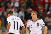 Dejected Miroslav Klose and Bastian Schweinsteiger of Germany after being knocked out of the tournament during the 2010 FIFA World Cup South Africa Semi Final match between Germany and Spain at Durban Stadium on July 7, 2010 in Durban, South Africa.