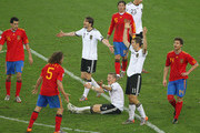 Arne Friedrich, Bastian Schweinsteiger and Miroslav Klose of Germany appeal during the 2010 FIFA World Cup South Africa Semi Final match between Germany and Spain at Durban Stadium on July 7, 2010 in Durban, South Africa.