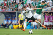 Julian Draxler of Germany battles for the ball with Rafael Marquez of Mexico during the 2018 FIFA World Cup Russia group F match between Germany and Mexico at Luzhniki Stadium on June 17, 2018 in Moscow, Russia.