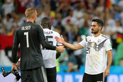 Robin Olsen of Sweden is consoled by Jerome Boateng and Ilkay Guendogan of Germany following the 2018 FIFA World Cup Russia group F match between Germany and Sweden at Fisht Stadium on June 23, 2018 in Sochi, Russia.