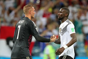 Robin Olsen of Sweden is consoled by Jerome Boateng of Germany following the 2018 FIFA World Cup Russia group F match between Germany and Sweden at Fisht Stadium on June 23, 2018 in Sochi, Russia.
