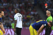 Referee Szymon Marciniak gives Germany player Jerome Boateng a red card during the 2018 FIFA World Cup Russia group F match between Germany and Sweden at Fisht Stadium on June 23, 2018 in Sochi, Russia.