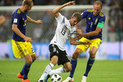Thomas Mueller of Germany is tackled by Andreas Granqvist and Ola Toivonen of Sweden  during the 2018 FIFA World Cup Russia group F match between Germany and Sweden at Fisht Stadium on June 23, 2018 in Sochi, Russia.