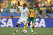 Kevin Prince Boateng of Ghana tussles with Brett Holman of Australia during the 2010 FIFA World Cup South Africa Group D match between Ghana and Australia at the Royal Bafokeng Stadium on June 19, 2010 in Rustenburg, South Africa.