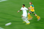 Kevin Prince Boateng of Ghana runs with the ball as he is closed down by Brett Holman of Australia during the 2010 FIFA World Cup South Africa Group D match between Ghana and Australia at the Royal Bafokeng Stadium on June 19, 2010 in Rustenburg, South Africa.